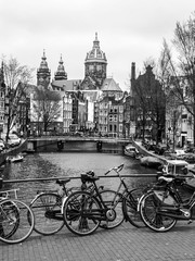 Canvas Prints Amsterdam Bicycles on a bridge in Amsterdam, Netherlands. Black and white image.