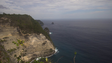 Seascape, rocky coast, ocean, blue sea, waves, Nusa Penida, Indonesia. Ocean with waves and rocky cliff Travel concept