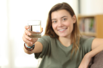 Healthy teen showing a glass of water