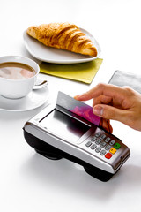 Credit card payment in cafe on white table background