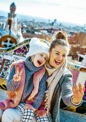 mother and daughter travellers taking selfie at Guell Park