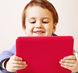 Social Media addiction. Happy little child girl  holding tablet as symbol of psychological problems of media mania.