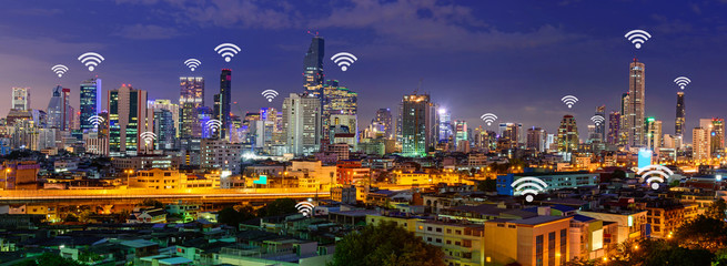 wifi in city / wifi sign and high building in the city panorama view