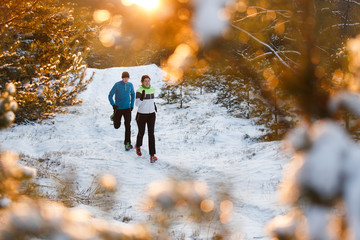Picture of running sports women and men in winter park