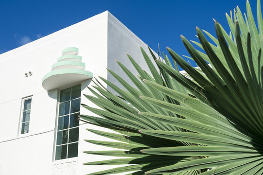 Detail of classic Art Deco architecture with palm fronds and blue sky in South Beach, Miami, Florida