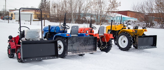 The concept of Minitractor using transport to remove snow