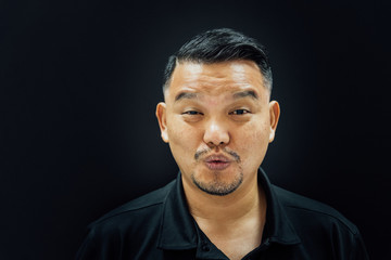 Asian man mouth whistle on background dark style