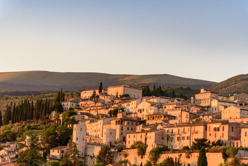 View of the medieval town of Spello in Umbria, Italy at sunset
