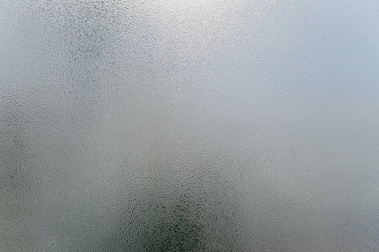 Window transparent blurred foggy glass with condensated water drops monochrome background. Vibrant freshness simplicity texture, season mood image