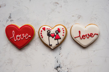Cookies hearts with white and red icing Love for Valentine's Day