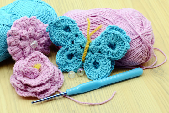 crocheting butterfly with crochet hook and wool.