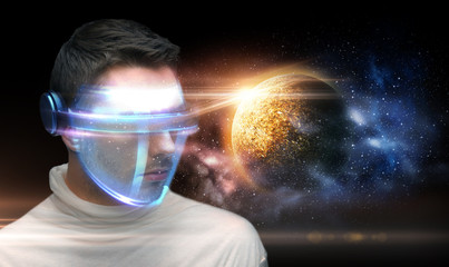 man in 3d glasses over planet and space