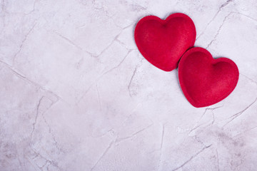 Red hearts on concrete background