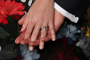 Britain'sPrincess Eugenie wears a ring containing a padparadscha sapphire surrounded by diamonds as she and Jack Brooksbank pose in the Picture Gallery after they announced their engagement, at Buckingham Palace, London
