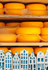 Dutch cheese with Delft souvenir houses in front