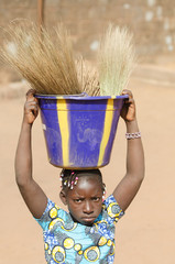 African Girl Holding Sink on Her Head - Human Rights Issue