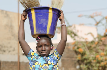 Beautiful African Child Helping Her Family - Child Labour Symbol for Africa
