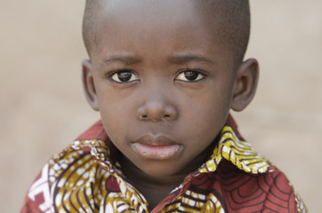 Little African Black Boy Looking Sad at Camera