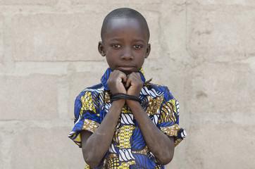 Headshot of African Black Boy Standing Outdoors Hands Rope