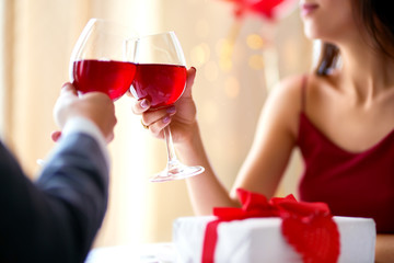Valentine's Day concept. Happy couple in love with. A young loving couple celebrating Valentine's Day in the restaurant. Lovers give each other gifts. Romance restaurant for Valentine's Day- concep