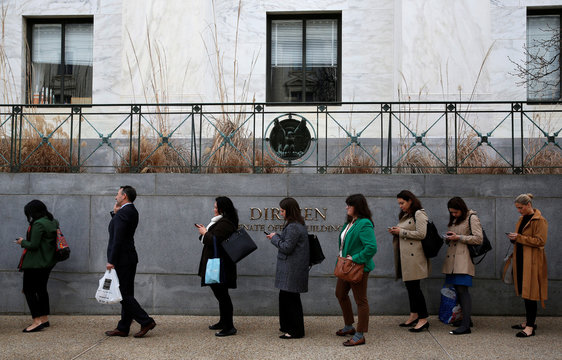 Congressional staffers wait in an excessively long line to enter the Dirksen Senate office building during the third day of a shut down of the federal government in Washington