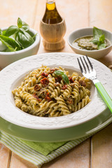 pasta with pesto pistachio and dried tomato,selective focus