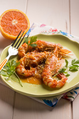 shrimp with orange and lemon sauce, selective focus