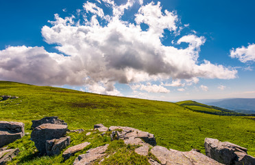 gorgeous cloudscape over the grassy hillside. beautiful mountain landscape in summertime