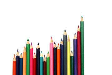 Growth chart of colored pencils on white background