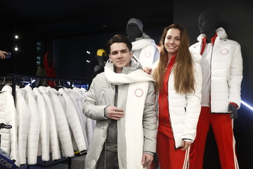 Russian short trackers Denis Airapetyan and Emina Malagich wear uniforms designed by ZASPORT, the official clothing supplier for national athletes competing in 2018 Winter Olympics, as they pose during its presentation in Moscow