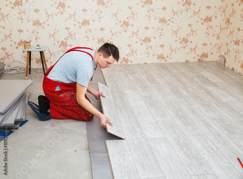 Handyman Laying Down Laminate Flooring Boards Stock Photo And