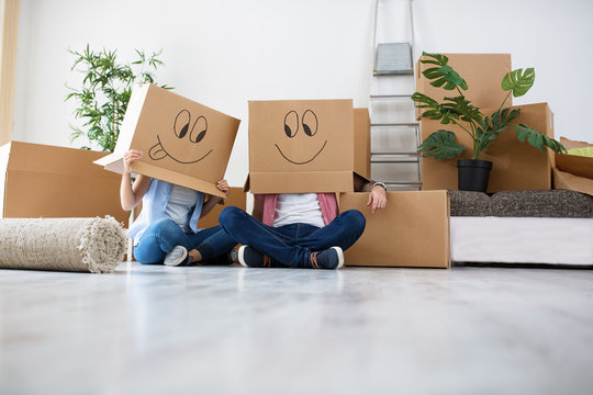 Funny young couple enjoy and celebrating moving to new home