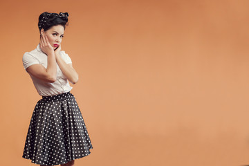 beautiful girl in vintage style on peach background