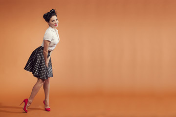 girl in vintage style on orange background