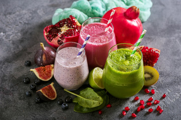 Colorful smoothie, healthy detox vitamin diet or vegan food concept, breakfast drink with spinach, pomegranate, figs and blueberries