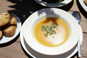 Fish soup dish from red scorpionfish, bread in the greek tavern.
