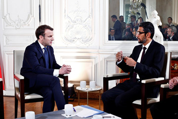 "French President Emmanuel Macron attends a meeting with Google CEO, Sundar Pichai, during the ""Choose France"" summit, at the Chateau de Versailles"
