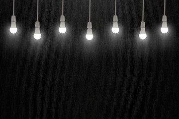 Light bulbs on dark grey texture background