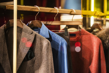 Men elegant clothing on hangers
