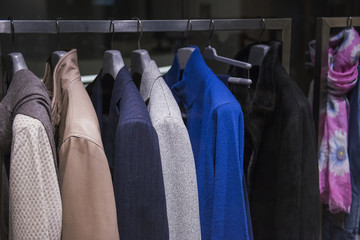 Men clothing on hangers in a fashion store