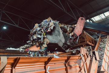 Garbage being loaded on container in recycling facility
