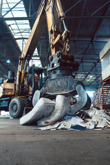 Grabber pre separating waste in recycling facility