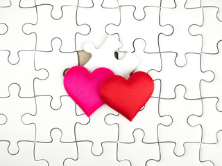 Colorful mini hearts on jigsaw puzzle pieces background, Valentine decorations, Various hearts