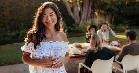 Woman with a drinks at outdoor party