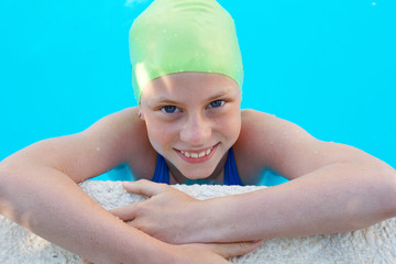 Portrait of little cute child in the swimming pool. Sport time
