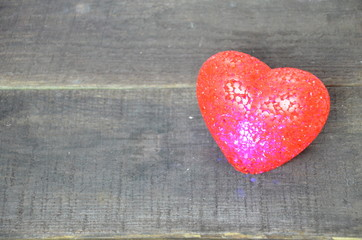 Valentine's Day symbol. Heart on a wooden background