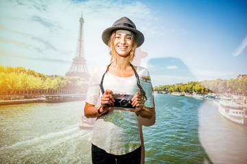 Portrait of a young woman traveler with projected image of landscape view on Paris with Eiffel tower