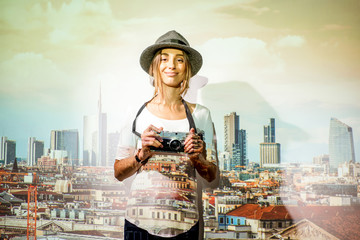 Fototapete - Portrait of a young woman traveler with projected image of Milan cityscape view in Italy