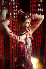 Retro portrait of a beautiful Gatsby woman. Smiling Girl. Vogue fashion style and smoke