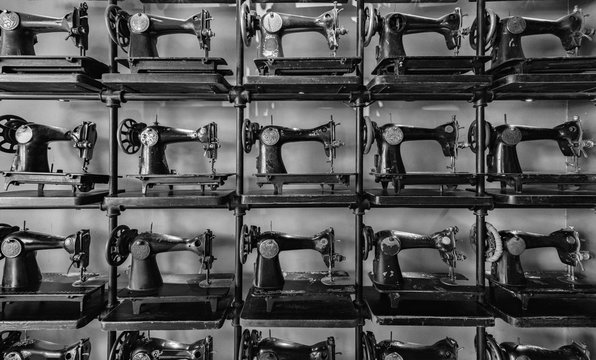 Old antique sewing machines. Background black and white pattern